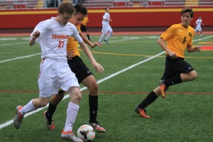 Michael Lynch '20 protects the ball from an attacking Friar.
