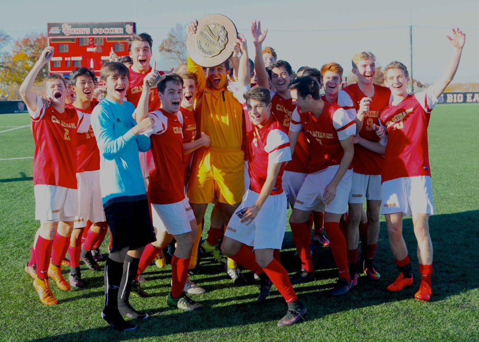 Elated after capturing Chaminade's sixth state title, the Flyers celebrate with candor. Photo Credit: Geoff Walter '01.
