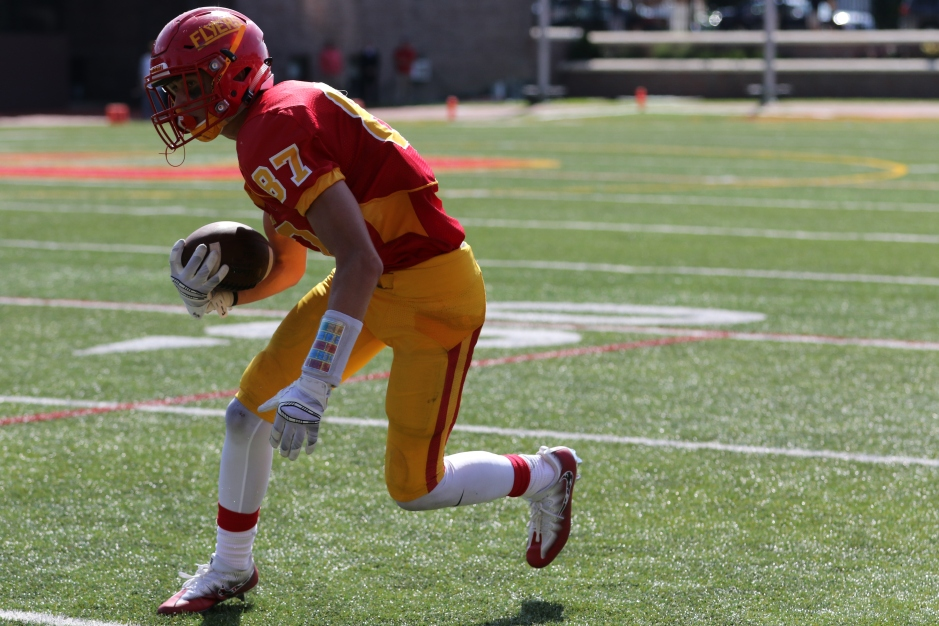 A core senior member of the Flyer offense, wideout Dominic Doria cuts in while scanning the field.