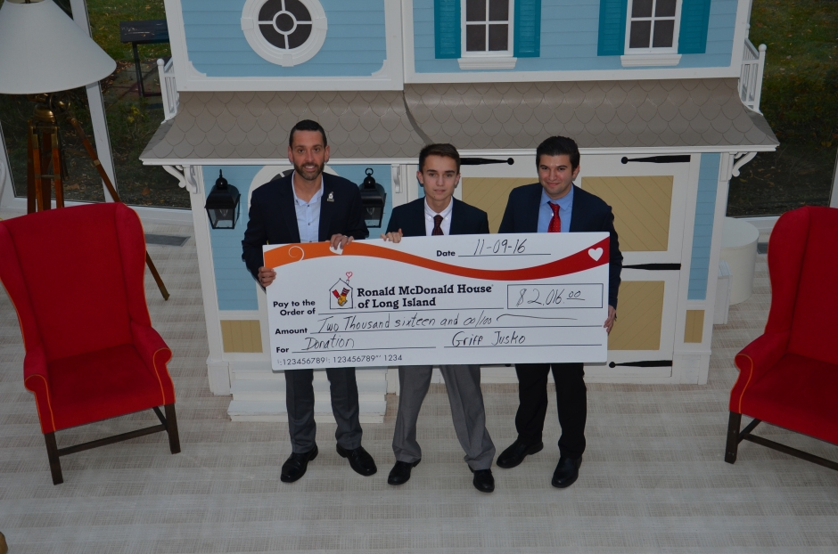 President of the Ronald McDonald House of Long Island, Matthew Campos, receives Griffin Jusko's donation along with Mr. Garofalo.