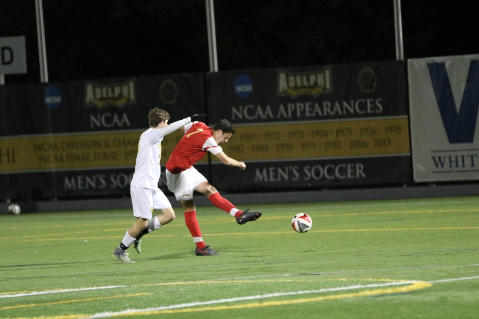 Newly-minted in the forward position, A.J. Codispoti '17 strikes a shot from 20 yards out.