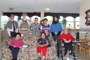The volunteers don a variety of costumes as they spend time with the residents of Queen of Peace.