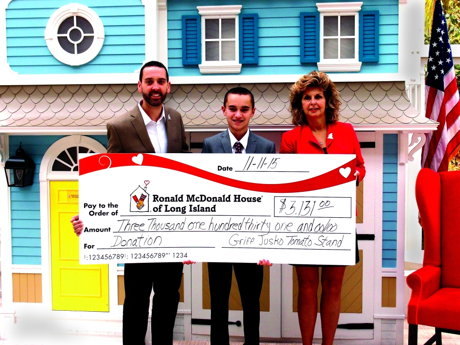 Griffin Jusko '19 presents his donation to the president of the Ronald McDonald House of Long Island, Matthew Campos, and Volunteer and Program Manager Betti McClellan.
