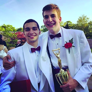 Thomas Miloscia '15 (left) smiles with best friend Tobias Hoonhout '15 after their graduation.