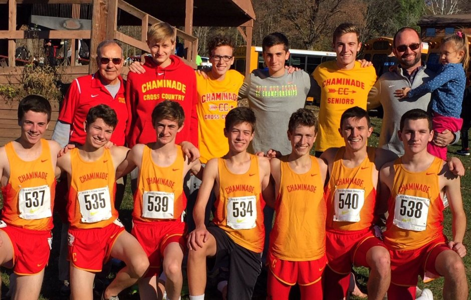 With coaches Carriero (back l.) and Beirne (back r.), the cross country team poses for an end-of-season photo.
