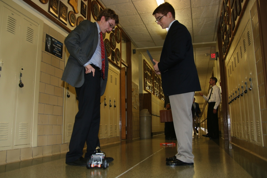 Jack Bauer '17 and Mark Bedoya '17 prepare for the Science Olympiad event Electric Vehicle.