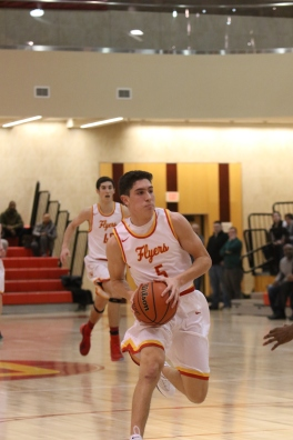 Michael O'Connell '20 attacks the basket.