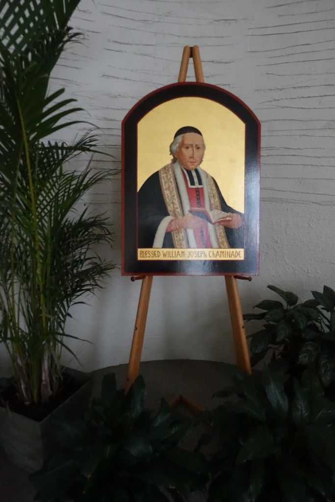 Located in Chaminade's chapel, an icon of Father William Joseph Chaminade is observable near the tabernacle.