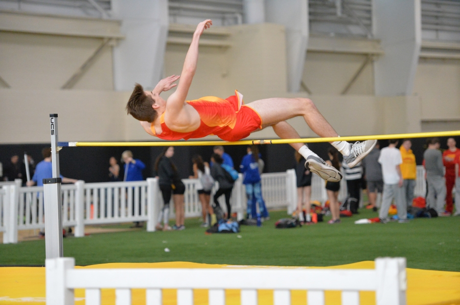 In the high jump, John Luke Hoonhout '17 propels himself with excellent form.