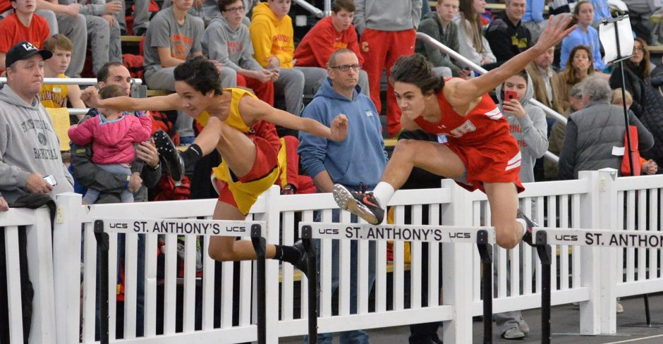 Alex Calderon '20 clears his hurdle while neck-and-neck with his opponent.