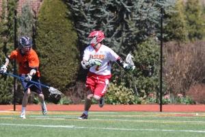 University of Virginia Lacrosse Commit Regan Quinn races past a Manhasset defenseman towards the goal.